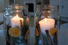 cinnamon stick and orange candles in jar