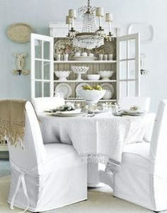 Taking the cottage look to the next level with a simple but  beautiful overall white theme with subtle inclusion of putty and biscuit accessories together with the glamorous shimmer of a crystal chandelier