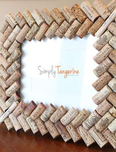 [Blog] A Corky Souvenir – Wine Cork Picture Frame - http://simplytangerine.com/2012/10/10/a-corky-souvenir-wine-cork-picture-frame/