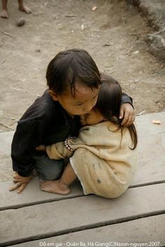 Nepal Earthquake 2015, a 4-year old boy hugs his  2-year old little sister.