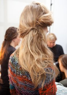 Love this side twisted braid. Messy hair style