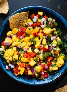This colorful mango salsa is super easy to make! It's sweet, spicy and absolutely delicious. Fresh mango salsa is great with chips, on tacos and more!