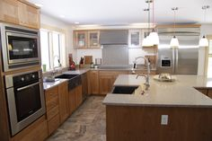 Dynasty by Omega kitchen cabinets from Ragonese Kitchen and Bath.  Two soapstone sinks used.