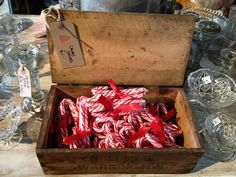 Sweet gifts. Ribbon tied candy canes in vintage box by Vintage Style Hire | The Curiosity Project