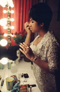 American soul singer Aretha Franklin applies makeup in her dressing room ahead of a concert at Newark Symphony Hall, Newark, New Jersey, United States, 1969, photograph by Walter Iooss.