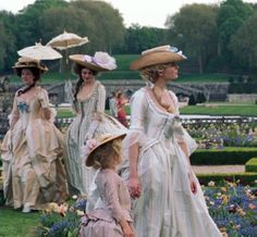Mom, daughter, & of course her ladies in the gardens of Versailles