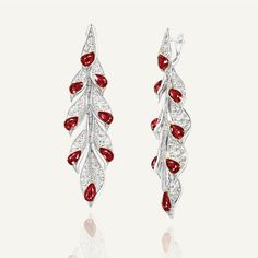 Forms Jewellery Hong Kong. This pair of earrings utilises natural pear rubies and marquise diamonds to bring about a modern touch to a traditional floral motif. The pair is further detailed with micro pave diamonds on the back, accentuating beauty from all angles. #FormsJewellery Ruby Earrings, Ruby Jewelry, Diamond Jewelry, Diamond Earrings, Harry Potter Jewelry, Marquise Diamond, Jewelry Companies, Floral Motif, Bohemian Jewelry