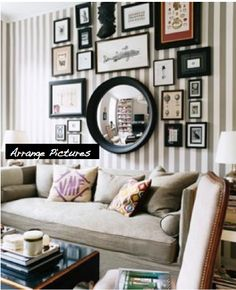 I love the circular mirror with this arrangement! It plays off the squares/rectangles...