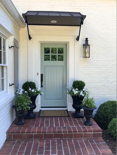 Front Door Paint Colors - Want a quick makeover? Paint your front door a different color. Here a pretty front door color ideas to improve your home's curb appeal and add more style! Front Door Awning, Front Door Planters, Front Door Entrance, Exterior Front Doors, Exterior House Colors, Exterior Paint, Exterior Design, Front Entry, Urn Planters