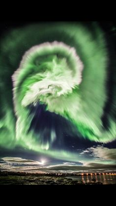 Aurora Borealis in a spiral form. Photographed on Iceland by Davide Necchi
