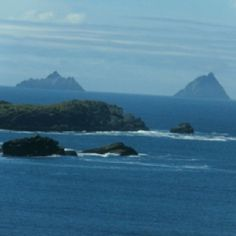 Skellig Michael - beautiful visage of the island (on the left) off the coast of Ireland...fascinating story!