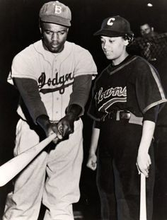 Jackie Robinson poses with Connie Morgan of the Negro League Indianapolis Clowns. Connie was one of three women to play in the Negro Leagues, along with Toni Stone and Mamie Johnson.
