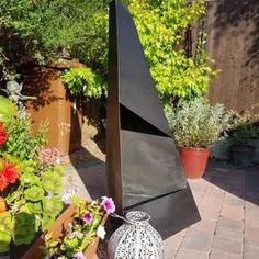 Pyro Monolith Metal Chiminea Vertical Fire Pit   Etsy Metal Chiminea, Chiminea Fire Pit, Exterior Metal Paint, Chimnea, Outdoor Fire, Outdoor Decor, Fire Pit Designs, Garden Spaces, Backyard
