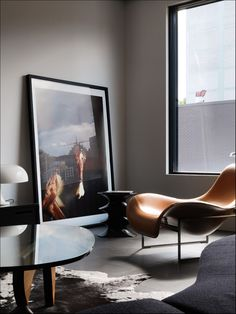 The Small House in Surry Hills, Sydney. Mart chair. Nesso lamp. Noguchi table. Hocker stool. Trevor Mein photograph.