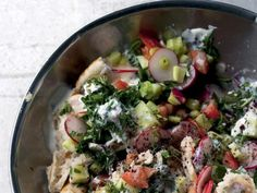 As Yotam Ottolenghi and Sami Tamimi write in the introduction to Na'ama's Fattoush in Jerusalem: A Cookbook, there is no escaping chopped salads in Jerusalem. Some are simple amalgamations of tomato, cucumber, onion, and lemon vinaigrette, while others, like Arab fattoush, contain a cornucopia of vegetables mixed with leftover pita bread.