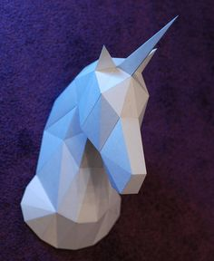 DIY model of lowpoly papercraft Unicorn wall trophy model. This is a digital PDF download template file. Specifications: Number of pages - 8 Print format - А4 Assembled sizes (A4 page format) Height - 33,9 cm / 13,3 inches Width - 19,8 cm / 7,8 inches Depth - 40,3 cm / 15,8 inches By making a purchase and downloading our templates you are agreeing use it for personal use only. Please do not share or distributing this template.