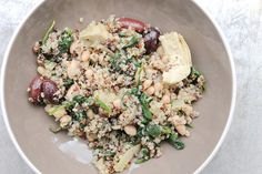 This Mediterranean quinoa is made with tasty ingredients including olives, artichokes, and baby spinach, and is then tossed with olive oil and white beans for a quick and satisfying meal. #Mediterraneanrecipes #quinoarecipes #quinoa