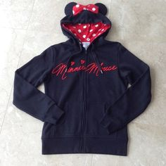 Minnie Mouse ears hoodie jacket Never worn and brand new. Purchased at Disney World Florida last year. Super cute and limited. Interior hoodie has the cute red and white Minnie polka dots. Disney Jackets & Coats