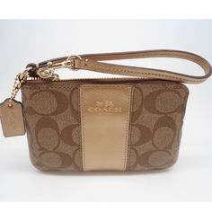 "New Item📸 Coach Signature Wristlet Signature PVC with Gold Leather Trim Coach Embossed on Front Brown Interior Lining Multi function Pocket 2 Slip Pockets Gold Tone Hardware Approximate Measurements:  6.25"" L x 4.25"" H Product Dimensions	6.7 x 3.9 x 0.4 inches Coach Bags Clutches & Wristlets"