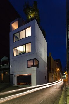 Small House is an ultra-compact concrete vertical house that adds to the urban fabric of inner city Surry Hills in Sydney.