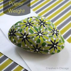 Create a unique paper weight...I got just the rock for this...@Shae Simoneau