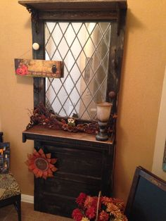 Old Door Hall Tree.  This was an old old door with a leaded glass window.  Heather turned the glass into an antique mirror, I added a couple shelves and brackets.  The doorknobs are from my grandfathers house. We saved this door from the dumpster at a local door company....