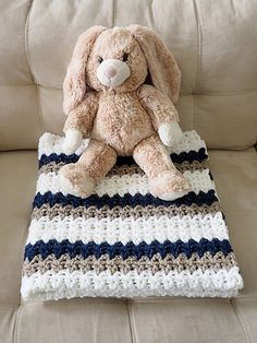 This crochet baby blanket is about as easy as it gets. As long as you can chain and double crochet, you can whip up one of these blankets yourself. Feel free to change up the colors and customize for either gender or to go with the nursery decor.
