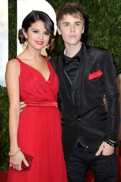 Selena Gomez and Justin Bieber arrive at the 2011 Vanity Fair Oscar party.