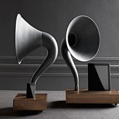iPhone / iPad Gramophone - Amplifying Speaker Horn. Just slide your iPhone or iPad into the solid walnut dock and the giant iron and brass horn speaker will amplify its volume up to 4X.