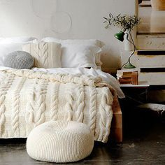 This cable knit blanket makes this bed look wonderful and cozy.     soukshop.com/...