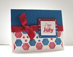 handmade 4th of July card from Deb's Card Buffet: Patriotic Hexagons ... red, white and blue ... luv the strong color ... Debbie used the Paper Trey Ink hexagon cover dit the for hexagon grid in white with hexagons stamped with patterns in red and blue ... beautiful card!