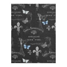 French Fleece Blanket    Butterflies, the Eiffel Tower, vintage scroll work - so many beautiful images and French words and phrases including vintage labels for wines (vins) and chocolat - are set against a black background. Two lovely vintage blue butterflies add a touch of color. Perfect for the lover of Paris and all things French. Matching items and other Paris and French themed designs are available in my Zazzle store.
