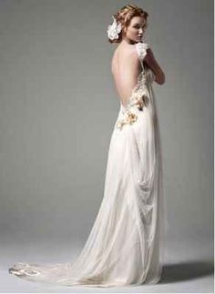 With delicate floral embellishments. | 36 Of The Most Effortlessly Beautiful Boho Wedding Dresses Ever