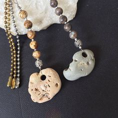Items similar to Holey stone, witch stone, hag stone ball chain pull, ornament or key ring. Decorative Ceiling Fans, Ceiling Fan Pulls, Hag Stones, Light Pull, Rock Collection, Beach Stones, Pull Chain, Key Rings, Holiday Crafts