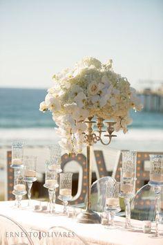 Romantic white beach wedding reception; Featured Photographer: Ernesto Olivares, Featured Event Design: Très Chic Affairs