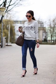 Love the idea of dressing up a sweatshirt...Great look, but with fun flats instead and jeans with out holes.