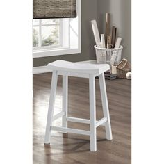 Improve the look of your home furniture with the White Saddle Seat Bar Stools. Made of quality materials, these bar stools are both durable and stylish.