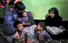 Mohammad Rafique, a Rohingya Muslim from Myanmar, begs a Bangladeshi coast guard official not to send his family back to Myanmar.