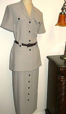 This 100% Polyester long designer dress by Amanda Smith has a button front safari style and it is long. It fully buttons in the front. There are removable shoulder pads. It has a belt that is made of