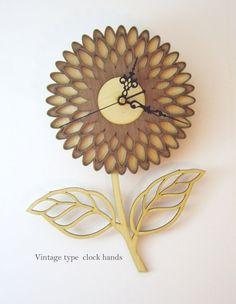 Handmade decorative wall clock, cut with precision laser cutter machine. All…