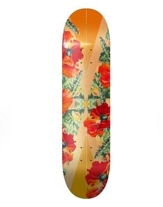This is a neat skateboard design. I like how the image appears to be tropical with its uses of bright, bold colors. Also this feel is created with the use of flowers and what appears to the sunrays in the background. Sand Skateboard.