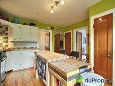 Cuisine - Triplex à vendre à Montréal dans le quartier Rosemont, contactez Emmanuelle au 451-751-1551, $579,000