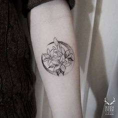 Moon and lilies on the left inner forearm.