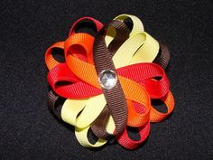 Thanksgiving Daisy Flower Hair Bow. I love the twist to the loops. Cute!