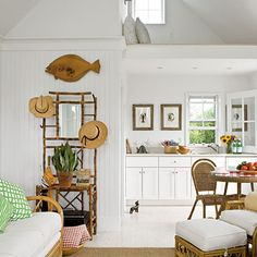Carpenter Michael Haigley carried the white finish of these walls to the ceiling, and installed clerestory windows for additional brightness. | Coastalliving.com