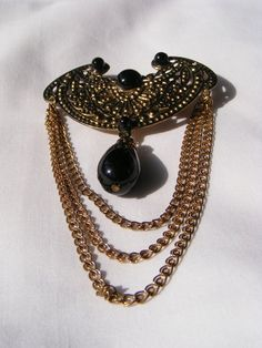 Vintage Gold Tone Brooch with Chains and Black Plastic Cabochons, $4.00 on Etsy