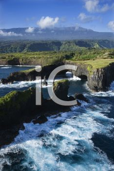 iCLIPART - Royalty Free Photo of an Aerial of a Rocky Coast on Pacific Ocean in Maui, Hawaii