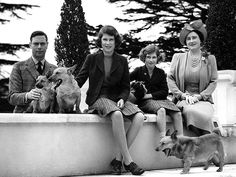 COUNTRY LIVING  The royal family – King George VI, Queen Elizabeth, Princesses Elizabeth and Margaret – pose at the Royal Lodge in April 1940 with several of the family's pet dogs. The queen's love of corgis is well known, and they have the run of Buckingham Palace to this day.