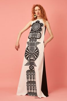 So interesting totem pole imagery that suits the woman, the construction of the dress, and the way her body moves.