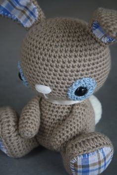 Cute Amigurumi bunny. In a different language but lots of pics. Might have to try to guess the pattern.